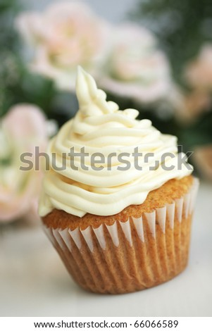 Delicious vanilla cup cake with white icing - stock photo