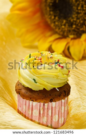 Delicious vanilla cup cake with yellow icing