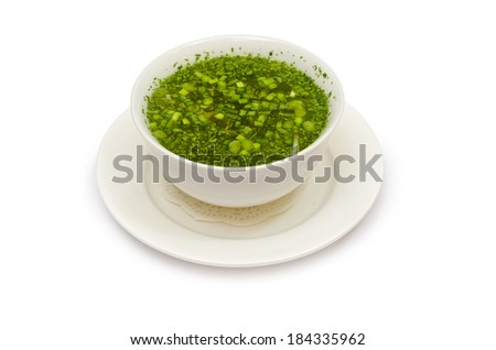 delicious vegetable carrot soup with greens isolated on white background - stock photo