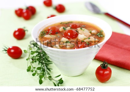Delicious vegetable stew  with tuna, beans and cherry tomato - stock photo