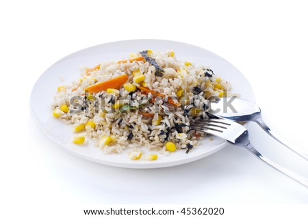 Delicious Vegetarian Fried Rice, containing carrot, corn, seaweed, and basil. - stock photo