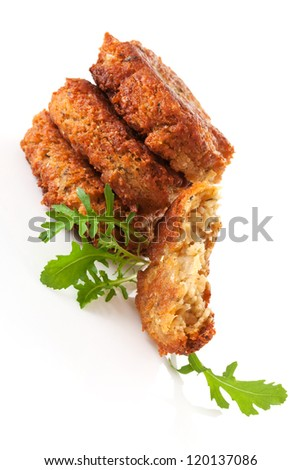 Delicious veggie burger patty with fresh herbs isolated on white background. Culinary vegan eating.