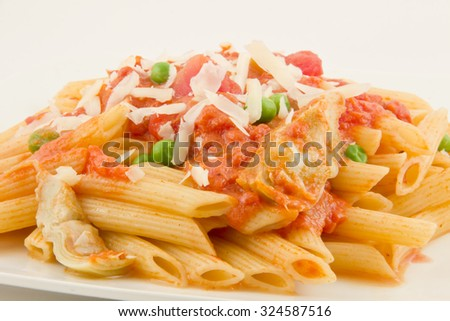 Delicious vodka penne garnished with basil leaves
