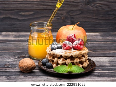 Delicious waffles with berries and honey. Breakfast. - stock photo