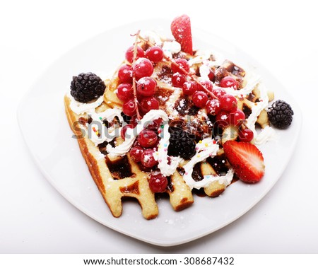 delicious waffles with blackberry, strawberry, red currant and cream. - stock photo