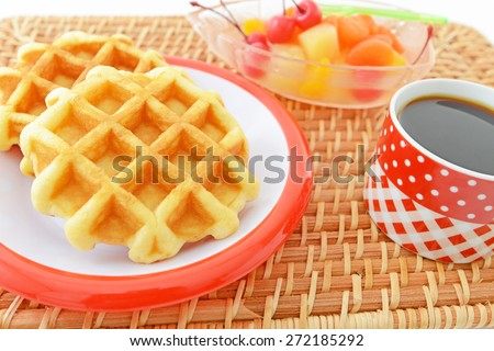 Delicious waffles with coffee - stock photo
