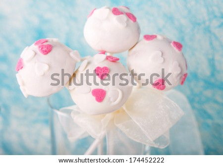 Delicious wedding, birthday or Valentin's day cake pops in white and soft blue - stock photo