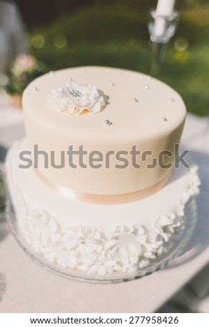 delicious wedding cake from layers with mastic - stock photo