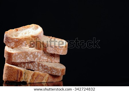 delicious wheat bread isolated on black - stock photo