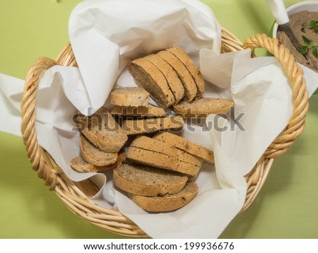Delicious whole wheat bread in a backet on party table. - stock photo
