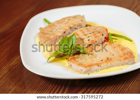 Delicious, wholesome food. Chops with vegetables. Pork chops on a plate with vegetables. - stock photo