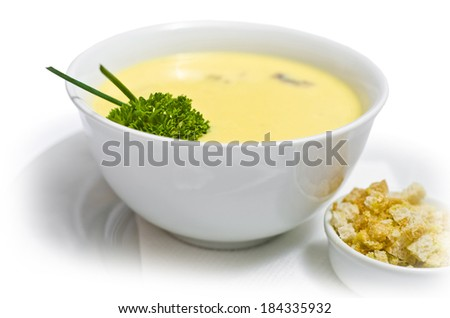 delicious yellow puree soup with crackers isolated on white background - stock photo