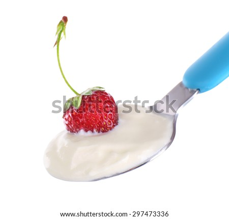 Delicious yogurt in spoon with strawberry isolated on white