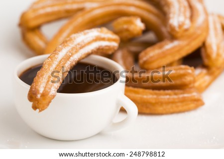 deliciuos spanish Churros with hot chocolate - stock photo