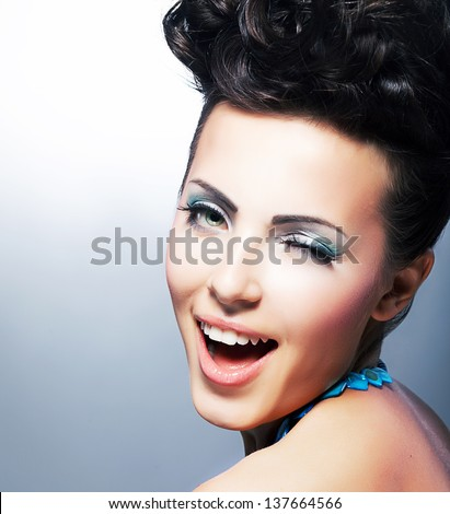 Delight. Happy Flirtatious Coquette smiling. Quizzical Smile - stock photo
