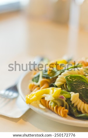 Delightful and vibrant tricolor pasta salad with healthy vegetables