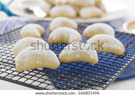 Delightful fresh baked Kourabiedes - a Greek butter cookie on a baking tray. - stock photo