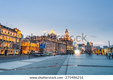 delightful scenery of the bund in shanghai ,old buildings and riverfront boulevard at dusk - stock photo