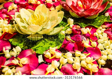 Delightful White Jasmine and rose Flowers Floating on Water - stock photo
