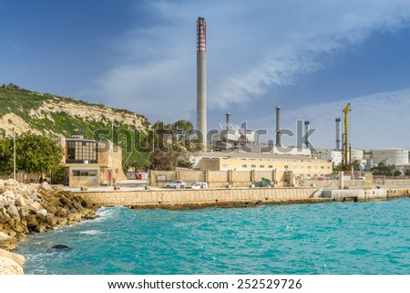 DELIMARA, MALTA-Feb 4th, 2015. Delimara power station in Marsaxlokk. Malta has no domestic resource of fossil fuels and no gas distribution network. Primary energy supply is exclusively based on oil - stock photo