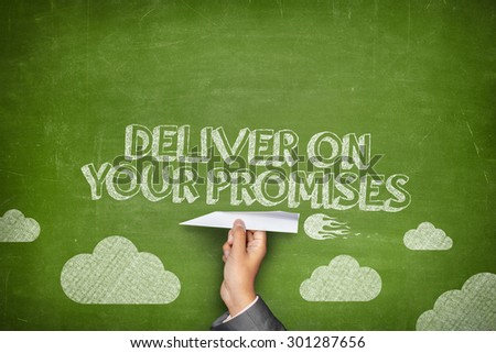 Deliver your promises concept on green blackboard with businessman hand holding paper plane - stock photo