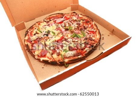 Delivered pizza in box isolated on white - stock photo