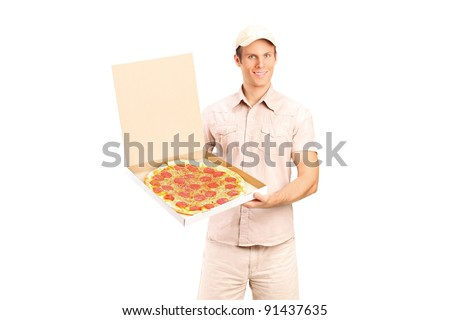 Delivery boy holding a pizza isolated on white background - stock photo