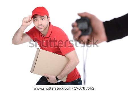 Delivery boy in a rush delivering a package isolated against white background - stock photo