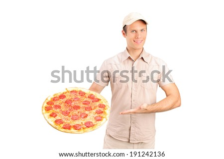 Delivery guy holding a pizza isolated on white background - stock photo