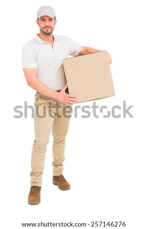 Delivery man carrying cardboard box on white background - stock photo
