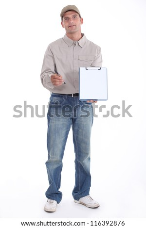 Delivery man holding up his clipboard for a signature - stock photo