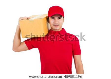 Delivery man in red uniform carrying parcel box - on white background