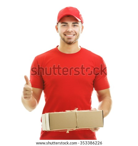 Delivery man in red uniform holding package isolated on white background - stock photo