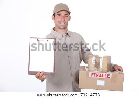 Delivery man requesting signature - stock photo