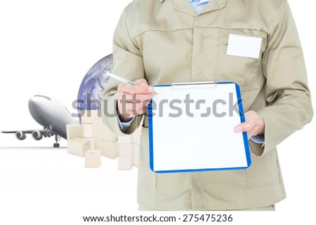 Delivery man showing blank paper on clipboard against logistics concept - stock photo