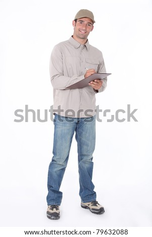 Delivery man with a clipboard - stock photo