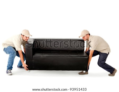 Delivery men carrying a big sofa - isolated over a white background - stock photo
