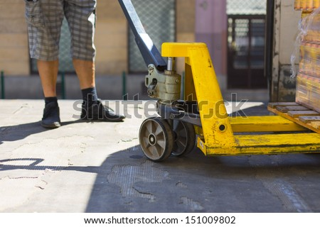 delivery of goods, loading pallets - stock photo