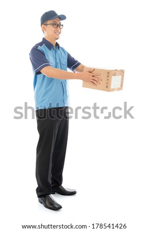 Delivery person delivering package smiling happy in blue uniform. Handsome young Asian man professional courier full length isolated on white background. - stock photo