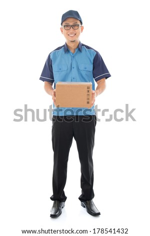 Delivery person delivering package smiling happy in blue uniform. Handsome young Asian man professional courier full length isolated on white background.