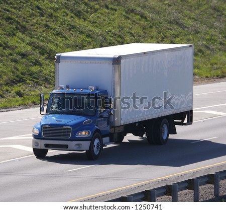 Delivery Truck on the Highway - stock photo