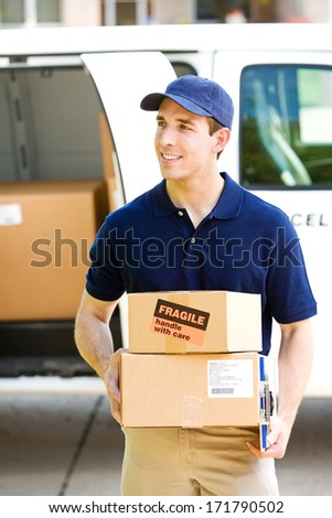 Delivery: Walking To House With Stack of Packages - stock photo