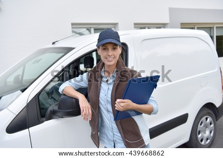 Delivery Woman Standing By Van Stock Photo 439668862 - Shutterstock
