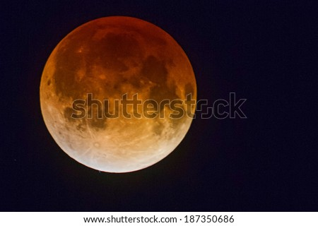 """Delray Beach-April 15:Full lunar eclipse, or """"blood moon"""", is visible in clear skies from east coast of south Florida, at 3:27 am EST, morning of April 15, 2014. - stock photo"""