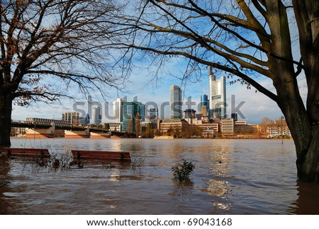 deluge - riverside road that is submerged in water. Flood in Frankfurt am Main, Germany - stock photo