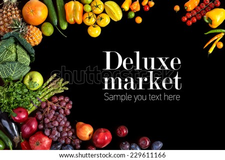 Deluxe market / studio photography of different fruits and vegetables on black backdrop  - stock photo