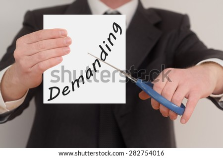 Demanding, man in suit cutting text on paper with scissors