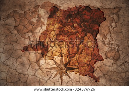 democratic republic of the congo map on vintage crack paper background - stock photo