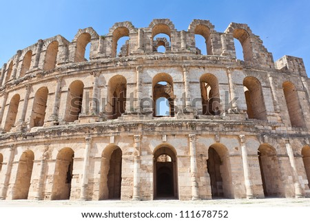 Demolished ancient walls and arches in Tunisian Amphitheatre in El Djem, Tunisia - stock photo