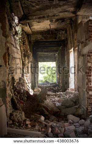 Demolished building after bombing. Ruin - stock photo